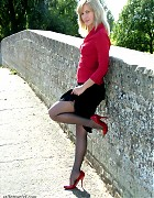 Sexy blonde with red high heels and gorgeous black nylons Picture 4