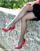 Sexy blonde with red high heels and gorgeous black nylons Picture 14