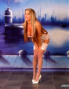 Wendi in white stockings and heels show her blond long hair Picture 1