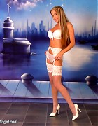 Wendi in white stockings and heels show her blond long hair Picture 2