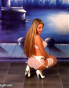Wendi in white stockings and heels show her blond long hair Picture 4