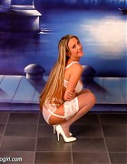 Wendi in white stockings and heels show her blond long hair Picture 5