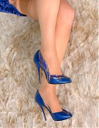 Chrissy show her blue pumps and tan stockings Picture 14